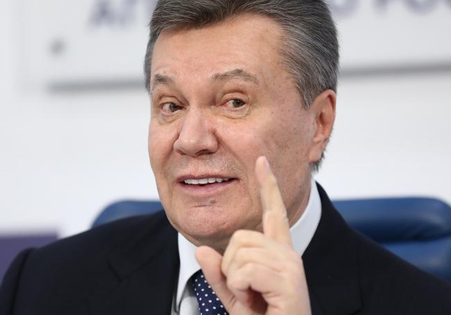 Суд дал Януковичу 13 лет за госизмену
