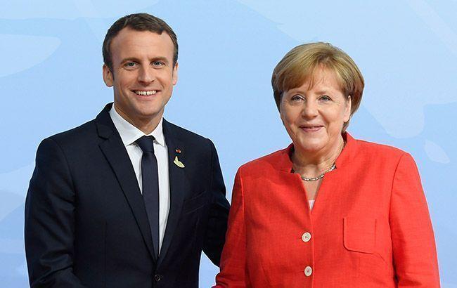 Макрон и Меркель приветствуют положительные сдвиги в реализации